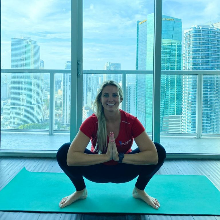 on the go wellness miami chiropractors demonstrating deep hip squat stretch