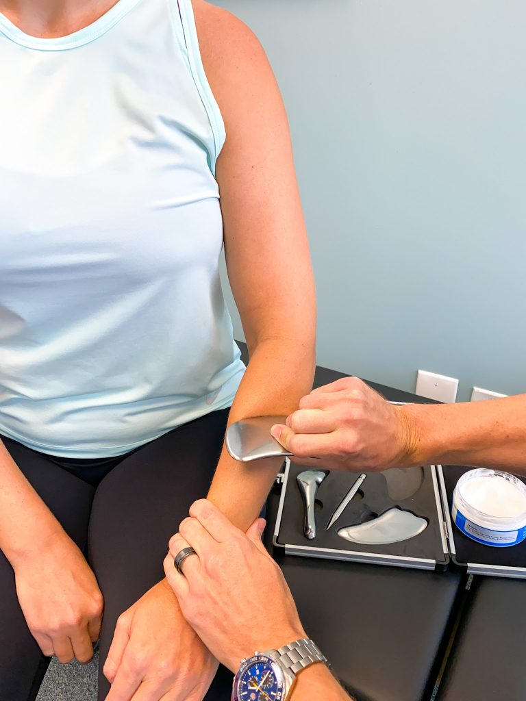 on the go wellness miami chiropractors performing graston technique