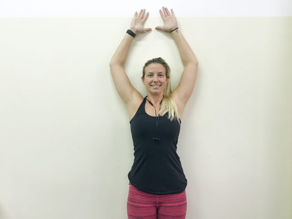 On The Go wellness chiropractor miami wall angels pose